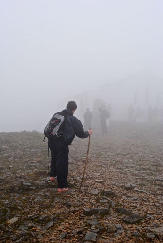 Barefoot pilgrim on summit of Croagh Patrick